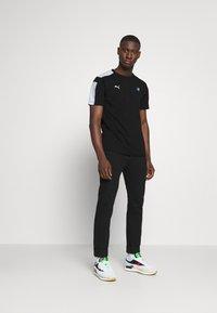 Puma - TEE - Print T-shirt - black - 1