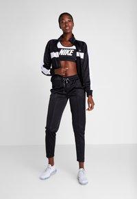 Fila - TRACK PANTS - Spodnie treningowe - black/bright white - 1