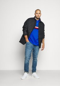 Tommy Hilfiger - CORE PACKABLE JACKET - Dunjacka - black - 1