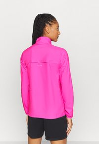 Puma - IGNITE WIND JACKET - Běžecká bunda - luminous pink - 2