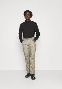 Alpha Industries - FLIGHT PANTS - Trousers - dark olive - 1