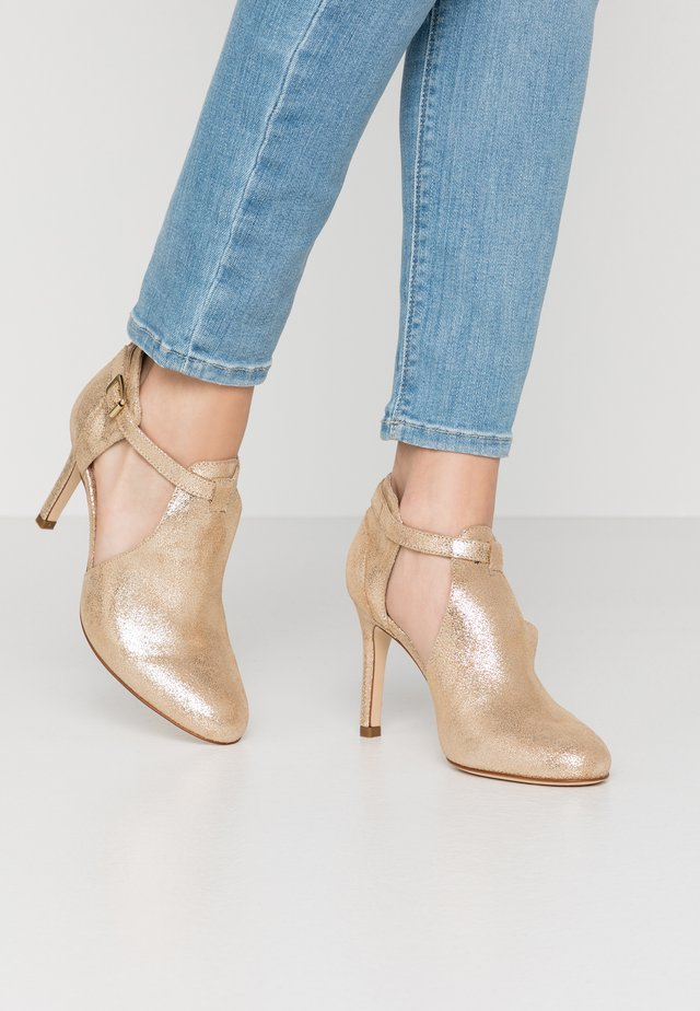 AVISINO - High heeled ankle boots - gold