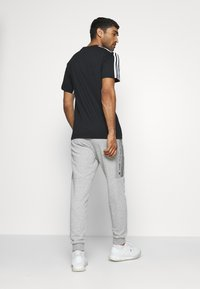 adidas Performance - Tracksuit bottoms - medium grey heather - 2
