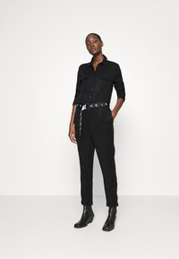 Calvin Klein Jeans - TAPERED UTILITY  - Jumpsuit - black - 1