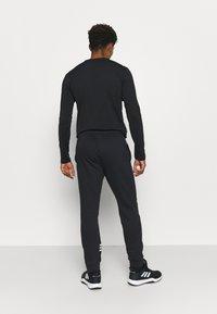adidas Performance - ESSENTIALS TRAINING SPORTS PANTS - Spodnie treningowe - black/white - 2