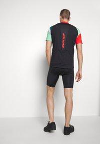 Ziener - NEPUMUK - Print T-shirt - black/fresh mint - 2