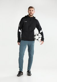 Hummel - TECH MOVE ZIP HOOD - Training jacket - black - 1
