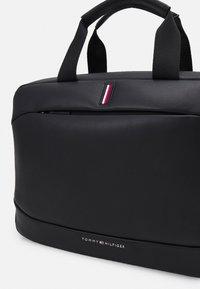 Tommy Hilfiger - HOUR BAG UNISEX - Across body bag - black - 4