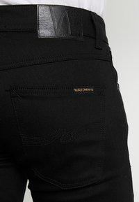 Nudie Jeans - GRIM TIM - Slim fit -farkut - dry ever black - 5