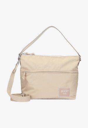 Käsilaukku - portabella