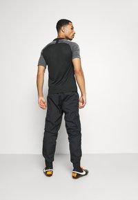 Nike Performance - LIVERPOOL PANT - Tracksuit bottoms - black/white - 2