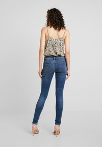 ONLY - ONLCORAL SUPERLOW - Jeansy Skinny Fit - dark blue denim - 2