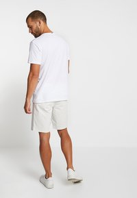 Esprit - FEATHER - T-shirt med print - white - 2