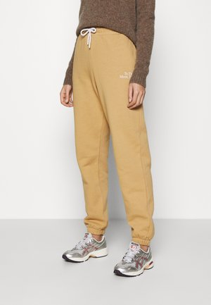 PAMA - Tracksuit bottoms - beige