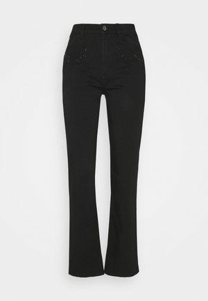 BLING - Trousers - black