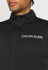 Calvin Klein Performance - TRACKSUIT - Tracksuit - black/bright white - 7