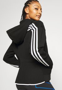 adidas Performance - HOODIE - Sweatjacke - black - 4