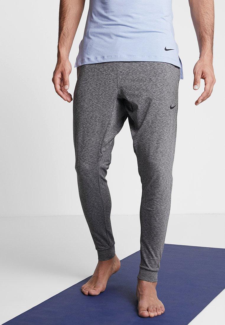 Nike Performance - M NK DRY PANT HPR DRY LT YOGA - Tracksuit bottoms - black