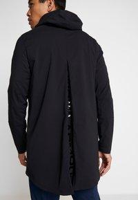 Under Armour - ACCELERATE TERRACE JACKET - Training jacket - black/metallic black - 6