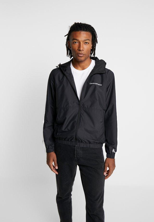 STATEMENT LOGO - Summer jacket - black/white