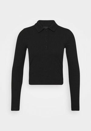 POPPY - Polo shirt - black