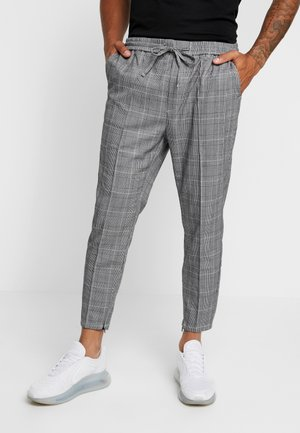 FLICK CHECK - Trousers - black