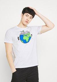 Puma - GRAPHIC TEE - Print T-shirt - white - 0