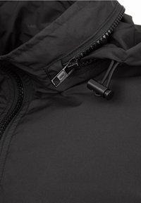 Urban Classics - Waterproof jacket - black - 2