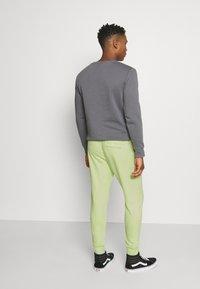 Nike Sportswear - PANT - Tracksuit bottoms - liquid lime - 2