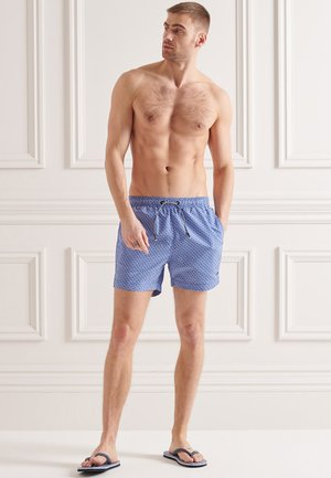 STUDIOS - Swimming shorts - wavy line cobalt