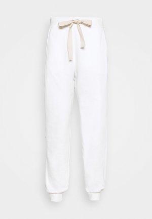 CITTA - Tracksuit bottoms - white