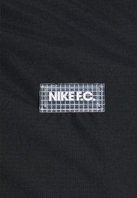 Nike Performance - Training jacket - black/black/white/clear - 5