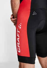 Craft - ADOPT BIB SHORTS - Tights - black/bright red - 4