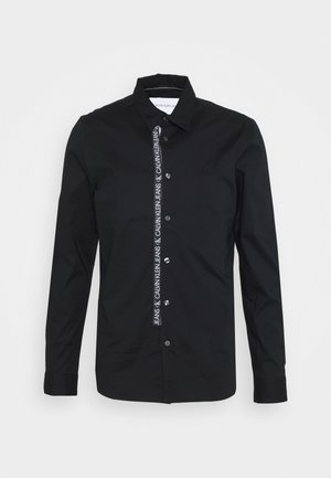 LOGO TAPE - Shirt - black