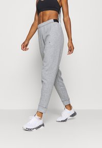 Puma - TRAIN FAVORITE JOGGER - Tracksuit bottoms - medium gray heather - 3