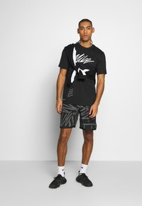 Nike Performance - DRY TEE PROJECT X - Camiseta estampada - black - 1