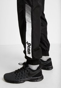 Penn - MENS GRAPHICA TRACK PANT - Tracksuit bottoms - black - 3