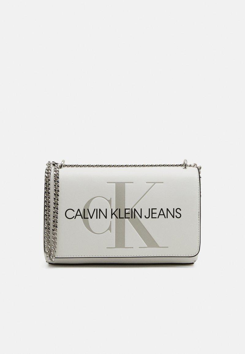 Calvin Klein Jeans - CONVERTIBLE FLAP - Across body bag - white