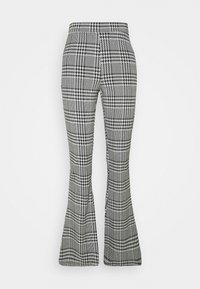 ONLY - ONLZIGA FLARED PANTS - Trousers - black/cloud dancer - 0