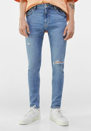 MIT RISSEN  - Jeans Skinny Fit - blue denim