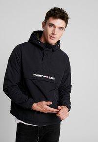 Tommy Jeans - PADDED POPOVER - Light jacket - black - 0