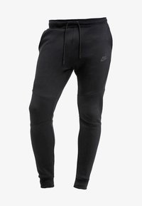 Nike Sportswear - Tracksuit bottoms - black - 6