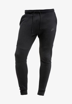 TECH - Tracksuit bottoms - black