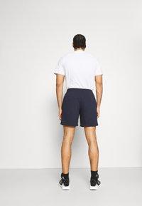 adidas Performance - Sports shorts - legink/white - 2
