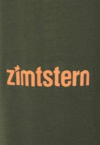 Zimtstern - PURE FLOWZ SHIRT 3/4 MENS - Funkční triko - forest night/bronze green - 2
