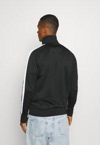Puma - ICONIC  - Training jacket - black - 2