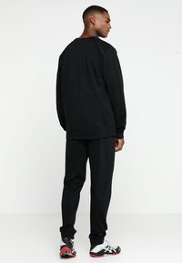 Hummel - HMLGO COTTON PANT - Tracksuit bottoms - black - 2