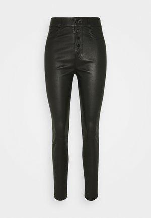 PLEUN - Leather trousers - black