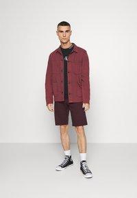 Calvin Klein Jeans - CENTER MONOGRAM CREW NECK - Sweatshirt - black - 1