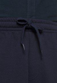 Lacoste - Verryttelyhousut - navy blue - 5